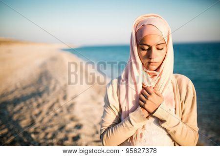 Young beautiful happy muslim woman outdoors portrait.Seaside,beach walk.Beautiful arab saudi woman