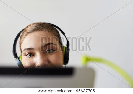 Woman With Green Earphones Listens Podcast Music On Tablet Pc