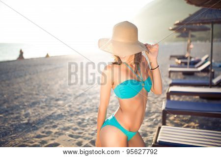 Sexy tanned female on the beach,beautiful slim woman on seashore,enjoying  summer day,beach party