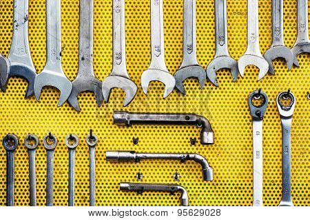 Neat Arrangement Of Tools On Yellow Pegboard
