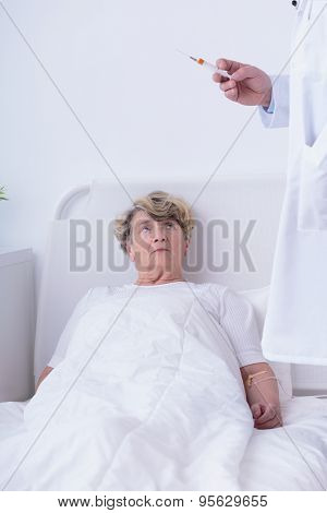Physician Preparing Injection