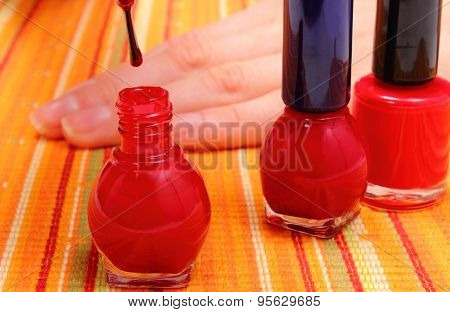 Applying Red Nail Polish, Manicured Nails Of Woman