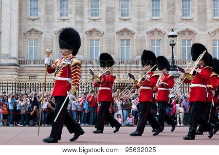LONDON - JUNE 24: British Royal guards, the Military Band perform the Changing of the Guard in Buckingham Palace on June 24, 2015 in London, UK. Guard change is one of the major tourist attraction