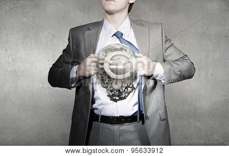 Young businessman acting like super hero of creativity