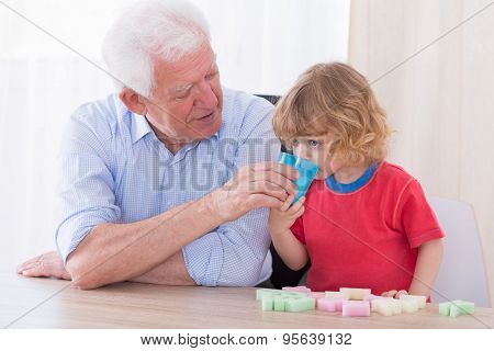 Helpful Grandfather And Boy