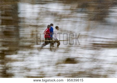 Joggers running on a snowy day