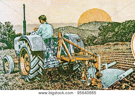Indian 5 rupee note depicting the importance of farming using modern equipment - tractor