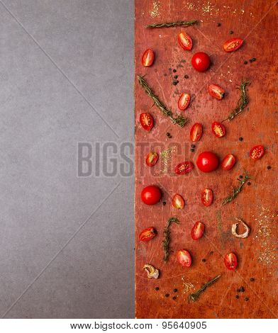 Tomatoes, Cooked With Herbs On The Old Wooden.