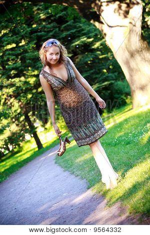 Girl Walk On Park Lawn