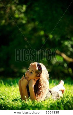 Girl Laying On Sunny Meadow