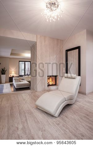 Comfortable Settee Near To Fireplace