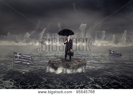 Man On The Sea With The City And Greek Flag Sinking