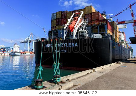 Haifa's Port dock with container ship and Various brands and colors of shipping containers