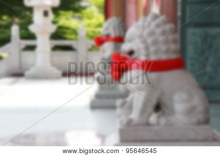 Blurred Twin Lion Statue In Temple Thailand.