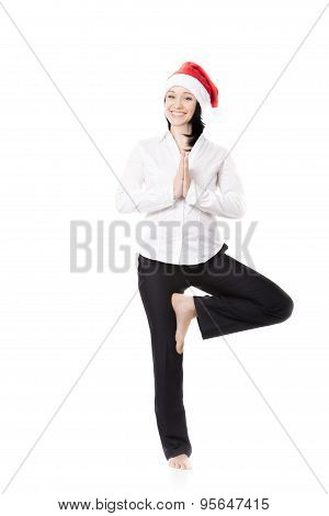 Young Office Woman In Yoga Pose In Santa Claus Hat On White Background