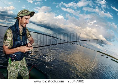 Happy Young Man Fishing On The Lake During Holidays