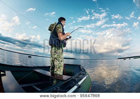 Man Fishing On The Lake During His Vacation