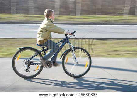 Boy Rides Bike