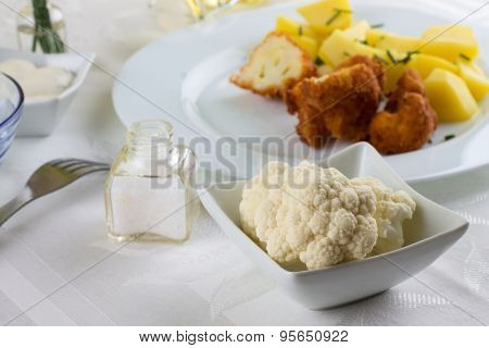 Few Pieces Of Cauliflower In White Bowl On Lunch Table