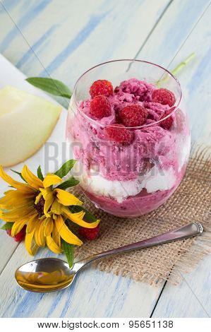 Glass Cup With Ice Cream With Spoon And Flower