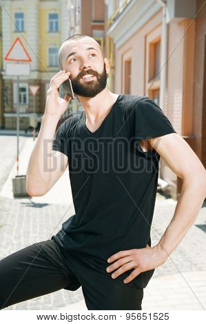 Handsome young man with beard in city