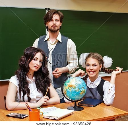 Two Teachers And Pupil Geography Lessons.