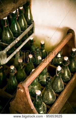 Old beer bottles in wooden cases, shot with shallow DOF
