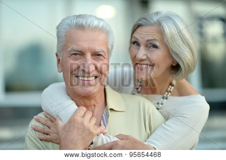 Happy nice mature couple walking