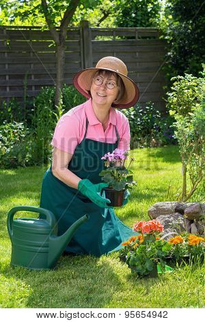 Smiling Middle Aged Woman Gardening