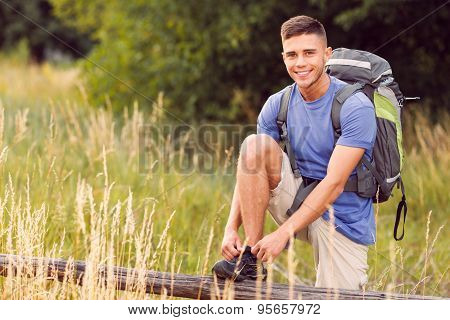 Young tourist hiking alone