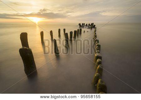 sea landscape, sea waves breaking on the breakwater
