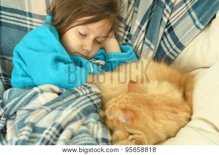 Sleeping  little girl with  red cat