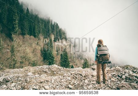 Young Woman with backpack relaxing outdoor