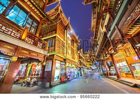 SHANGHAI, CHINA - JUNE 17, 2014: Shoppers in the Yuyuan Bazaar. The bazaar is adjacent to the Yuyuan Gardens which date from the Ming Dynasty and attracts many tourists.