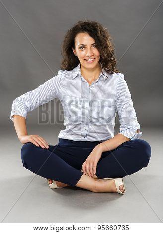 Happy Businesswoman Sitting On Floor