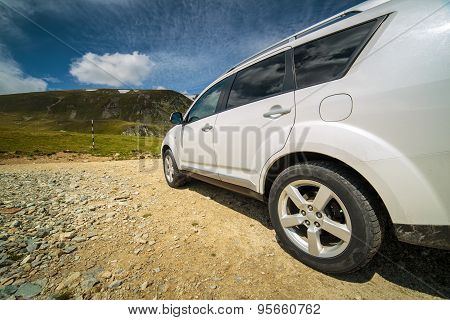 Offroad Car Near The Mountains