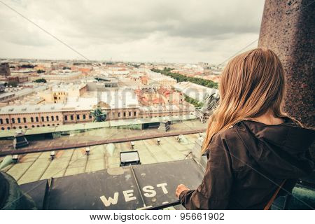 Young Woman relaxing outdoor with aerial view city on background