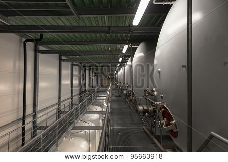 Large industrial white silos in modern factory