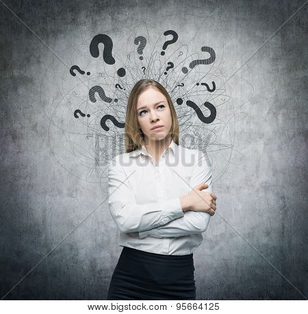 A Portrait Of A Beautiful Lady With Questioning Expression And Question Marks Above Her Head. Concre