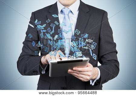 Businessman Is Searching Something In Internet Using A Tablet. Flying Social Media Icon.