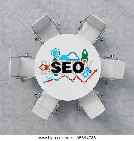 Top View Of A Conference Room. A White Round Table And Six White Chairs Around. Colourful Seo Flowch