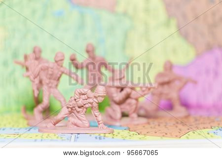 Toy Soldiers  on paper map background