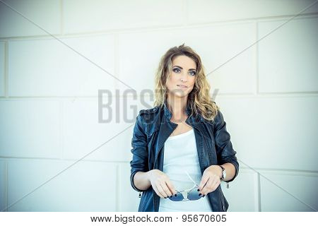 Fashion Girl Posing With Leather Jacket