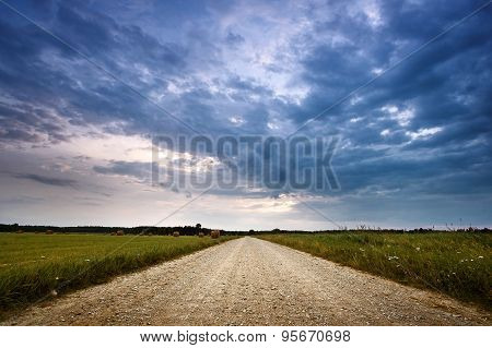 Evening country road with dramatic sky