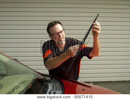 Mechanic Changing Windshield Wipers On A Crossover Suv