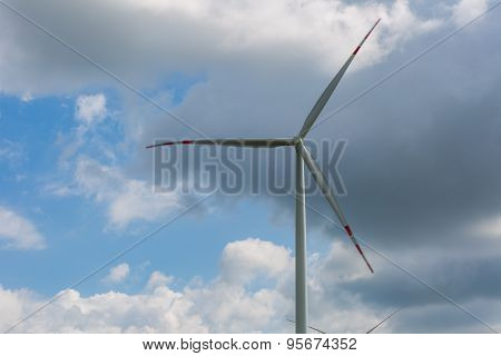 Windmill On Cloudy Sky Background