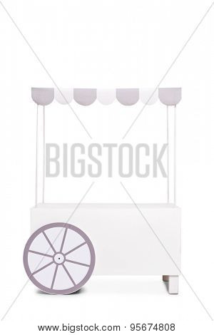 Vertical studio shot of an empty ice cream stand with a white and gray canopy isolated on white background