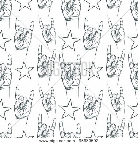 Seamless pattern with Rock n Roll sign and a stars.