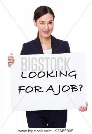 Businesswoman hold with a board showing phrase of looking for a job