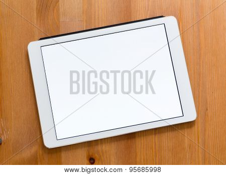 Digital Tablet on a desk and showing a blank screen for advertisting